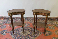 A pair of French inlaid walnut ormolu mounted kidney shaped occasional tables. (2)