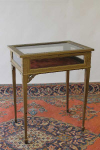 An early twentieth century display table, width 61 cm.