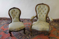 A Victorian walnut Lady's chair, together with a similar nursing chair. (2)
