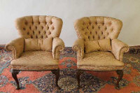 A pair of early twentieth century walnut armchairs. (2)