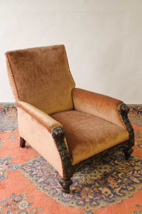 A carved oak framed lounge chair.