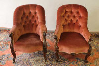 A near pair of Victorian walnut buttoned backed armchairs. (2)