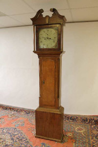 A nineteenth century oak longcased clock, with painted dial.