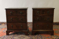 A pair of early nineteenth century walnut three drawer chests, width 53 cm. (2)