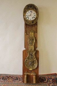 A French longcased chiming clock, with brass detail, mounted to board.