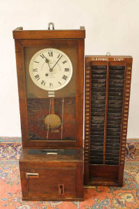 An early twentieth century Gledhill-Brook mahogany cased time recorder, together with mahogany clocking-in board. (2)