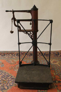 A nineteenth century cast iron weighing machine by J.W. Hill & Son.