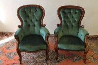 A pair of walnut Victorian Gentleman's chairs. (2)