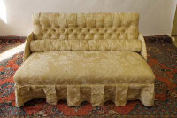 A nineteenth century settee upholstered in cream fabric, width 140 cm.