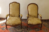 A pair of beech wood Lady's and Gentleman's chairs. (2)