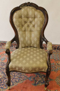 A Victorian walnut Lady's chair.