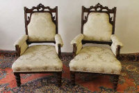 A pair of late Victorian mahogany armchairs. (2)