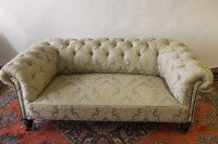 A Victorian chesterfield settee upholstered in floral green fabric, width 176 cm.