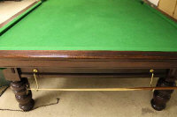 A full-size five-slate snooker table, length 384 cm, together with lighting shade, score board and accessories.