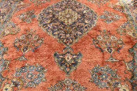 A fringed Persian carpet, 333 cm x 236 cm.