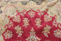 A fringed Persian design carpet 258 cm x 386.