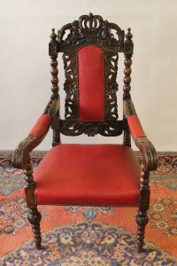 A carved oak armchair.