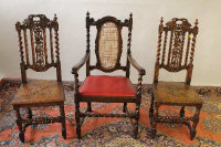 A carved oak armchair, together with a pair of nineteenth century oak chairs. (3)