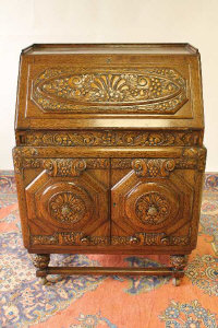 An early twentieth century carved oak bureau, width 79 cm.
