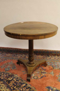 An early Victorian rosewood occasional table on carved pedestal base, width 74 cm.