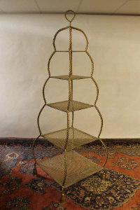 A gilt metal five tier display stand, height 200 cm.