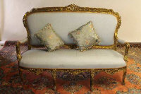 An early twentieth century gilt wood salon settee, width 162 cm.