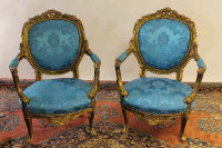 A pair of gilt wood armchairs. (2)