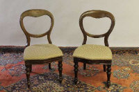 A set of four Victorian mahogany dining chairs. (4)