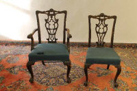 A pair of early twentieth century Chippendale style mahogany armchairs, together with four matching single chairs. (6)