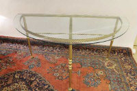 A pair of D-shaped gilt metal and glass topped tables, width 153 cm. (2)