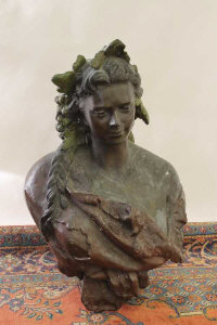 A cast bronze bust of a lady with grapes in her hair, height 97 cm.