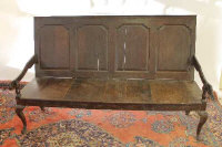 An eighteenth century oak panel backed settle, width 183 cm.