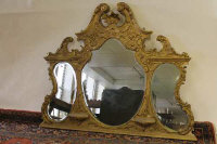 A nineteenth century gilt framed over mantle mirror, width 152 cm.