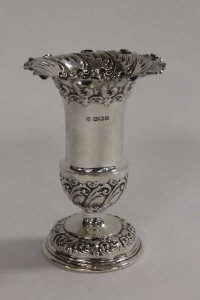 A silver embossed vase, Sheffield 1906, height 11.5 cm.