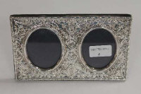 A silver embossed twin photograph frame, Birmingham 1994, width 20 cm.
