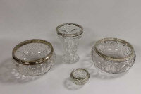 A silver mounted cut crystal vase, Sheffield 1930, together with three other silver mounted crystal bowls. (4)