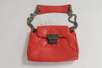 A Chanel red leather hand bag, with authenticity card no. 8922961.