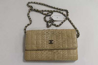 A Chanel cream leather skin hand bag, authenticity card no. 9116611.