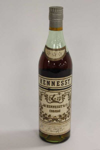 One bottle of early twentieth century Hennessy three star cognac, height 30 cm.