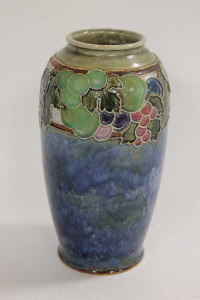A Royal Doulton tubelined vase decorated with berries, height 24 cm.