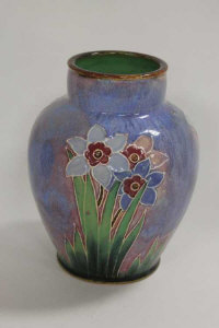 A Royal Doulton tubelined short vase decorated with flowers, height 17.5 cm.