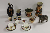 A collection of Royal Doulton collectables including an elephant, large Toby Jug, The Connoisseur flaggon etc. (14)