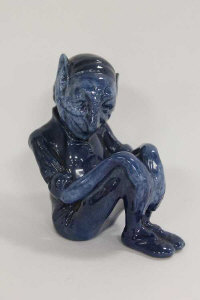 An extremely rare Royal Doulton Titanian figure -  A Gnome, in blue glaze, height 11 cm.