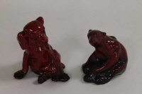 Two Royal Doulton flambe figures - Small polar bear and puppy. (2)