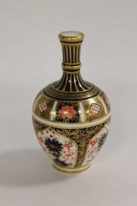 A Royal Crown Derby miniature vase decorated with Imari design 1128, height 13.5 cm.