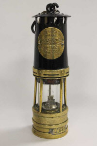 A Hailwood & Ackroyd five-bar type O1B miner's lamp, numbered 162, height 26 cm.