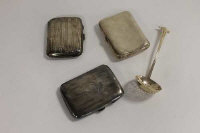 Three silver cigarette cases, together with a silver straining spoon. (4)