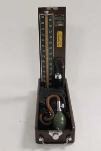 A collection of vintage medical equipment including sphygmomanometer, glass measures etc. (Q)