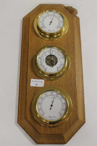 A carved oak brass mounted weather station by Robert 'Mouseman' Thompson of Kilburn.