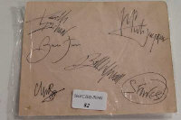 A group of early career signatures of The Rolling Stones, from an autograph book, signed in black ink.